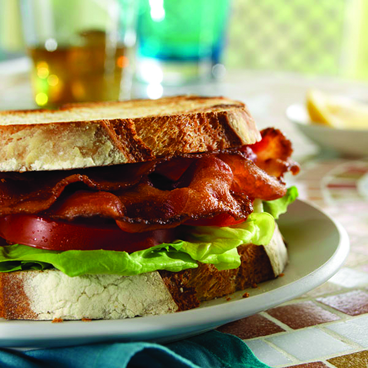 Nueske's Applewood Smoked Meats is specialty meat supplier in Wittenberg, Wisconsin. The company produces artisan applewood smoked bacon, ham, sausage and poultry. History. Nueske's was founded in the Great Depression when R.C. Nueske began.